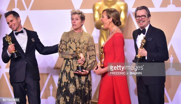 Actors Sam Rockwell, Frances McDormand, Allison Janney, and Gary Oldman, pose in the press room with their Oscars for best supporting actor, best...