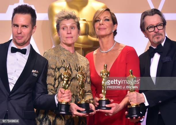 TOPSHOT Actors Sam Rockwell Frances McDormand Allison Janney and Gary Oldman pose in the press room with their Oscars for best supporting actor best...