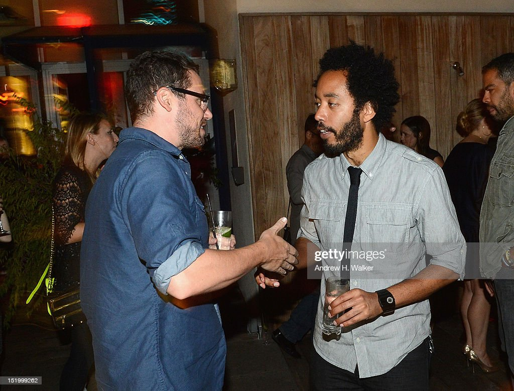 Actors Sam Rosen and Wyatt Cenac attend The Cinema Society with The Hollywood Reporter & Samsung Galaxy S III host a screening of 'The Oranges' at Tribeca Screening Room on September 14, 2012 in New York City.