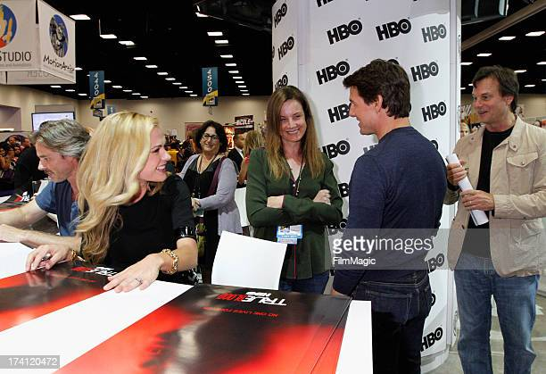 """Actors Sam Trammell and Anna Paquin with guest are visited by actors Tom Cruise and Bill Paxton at HBO's """"True Blood"""" Cast Autograph Signing at San..."""