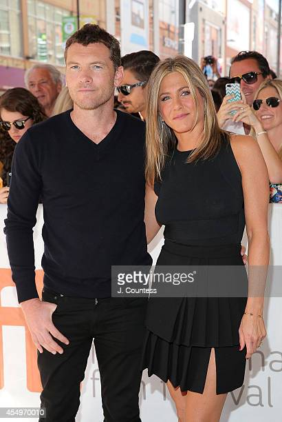 Actors Sam Worthington and Jennifer Aniston attend the premiere of 'Cake' at The Elgin at the 2014 Toronto International Film Festival on September 8...