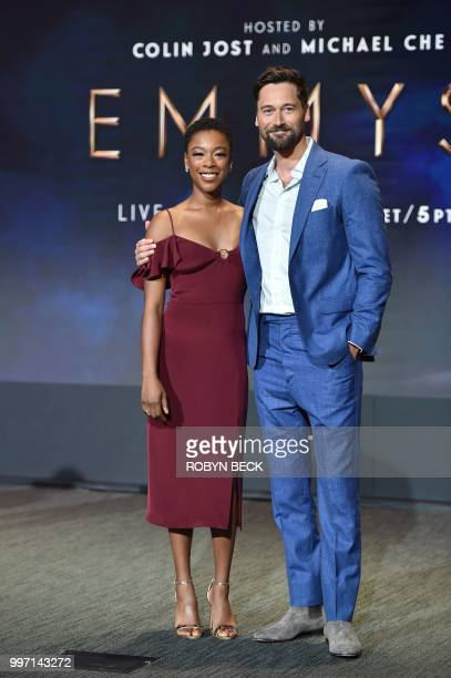 Actors Samira Wiley and Ryan Eggold pose on stage at the nominations announcement for the 70th Emmy Awards July 12 2018 at the Television Academy's...