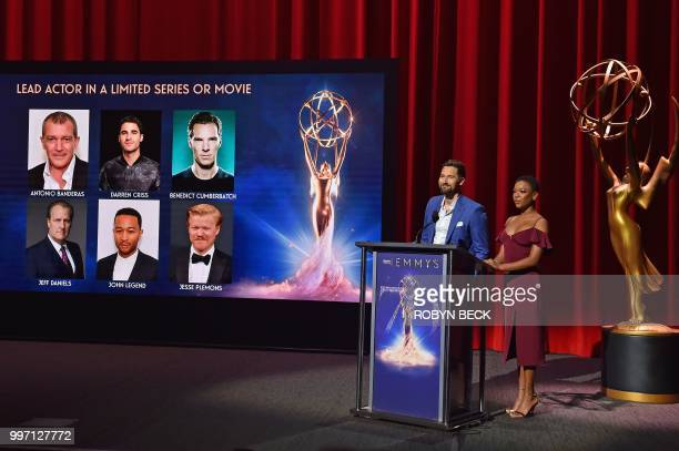 Actors Samira Wiley and Ryan Eggold speak on stage at the nominations announcement for the 70th Emmy Awards July 12 2018 at the Television Academy's...