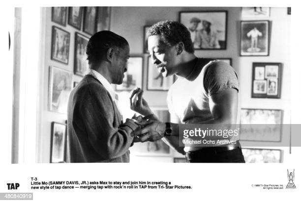 Actors Sammy Davis Jr and Gregory Hines talk in a scene from the movie Tap circa 1989