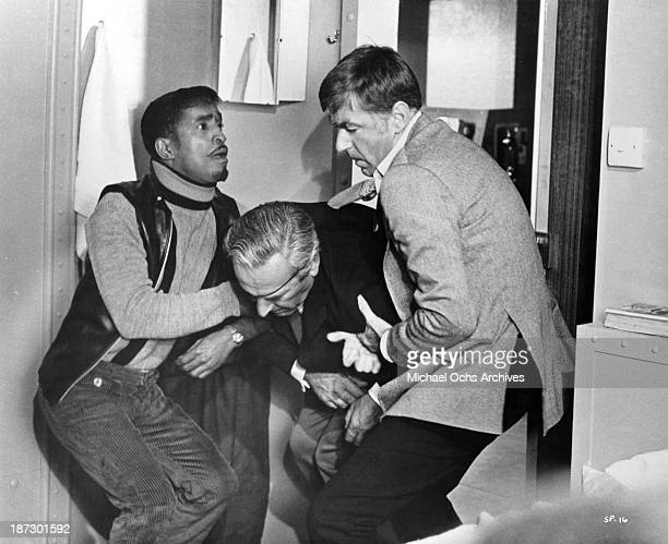 Actors Sammy Davis Jrand Peter Lawford on set of the movie Salt and Pepper in 1968