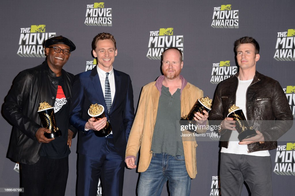 Actors Samuel L. Jackson and Tom Hiddleston, director Joss Whedon, and actor Chris Evans, winners of Movie of the Year for 'Marvel's The Avengers,' pose in the press room during the 2013 MTV Movie Awards at Sony Pictures Studios on April 14, 2013 in Culver City, California.