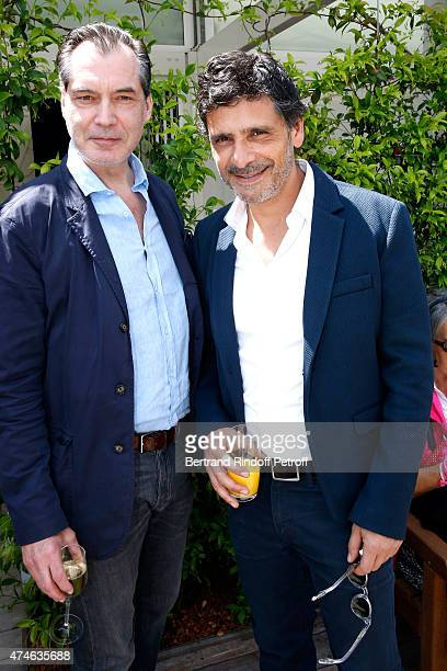 Actors Samuel Labarthe and pascal Elbe attend the 2015 Roland Garros French Tennis Open at Roland Garros on May 24 2015 in Paris France