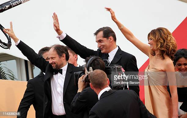 Actors Samuel Labarthe Denis Podalydes and Florence Pernel wave to fans as they attend the La Conquete Premiere during the 64th Annual Cannes Film...