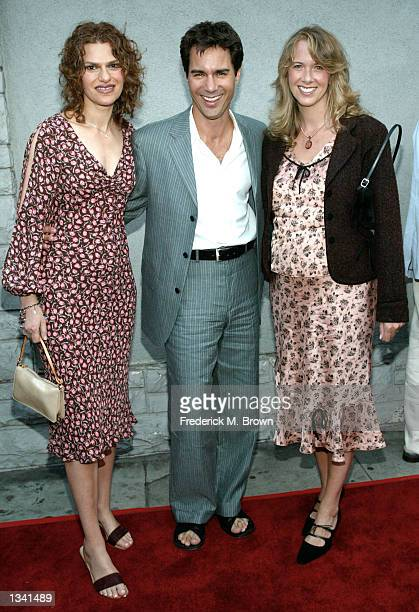 Actors Sandra Bernhard Eric McCormack and his wife Janet attend the Project Angel Food's Angel Awards 2002 on August 17 2002 in Los Angeles...