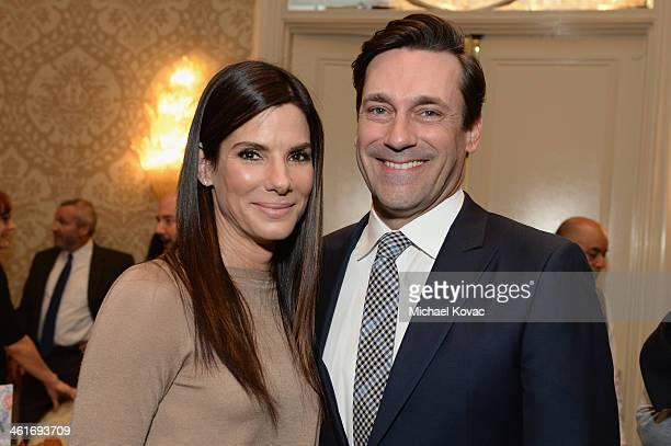 Actors Sandra Bullock and Jon Hamm attend the 14th annual AFI Awards Luncheon at the Four Seasons Hotel Beverly Hills on January 10 2014 in Beverly...