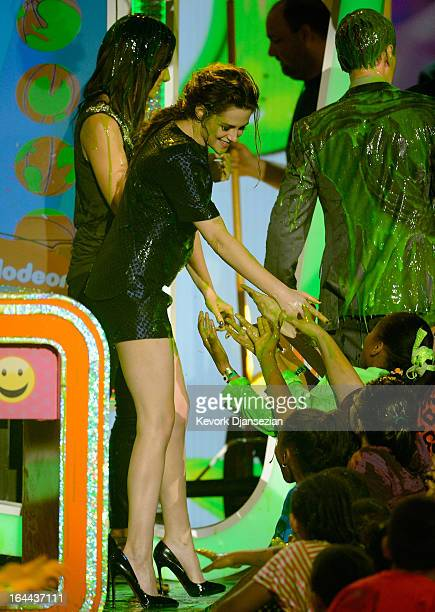 Actors Sandra Bullock Kristen Stewart and Neil Patrick Harris speak onstage during Nickelodeon's 26th Annual Kids' Choice Awards at USC Galen Center...