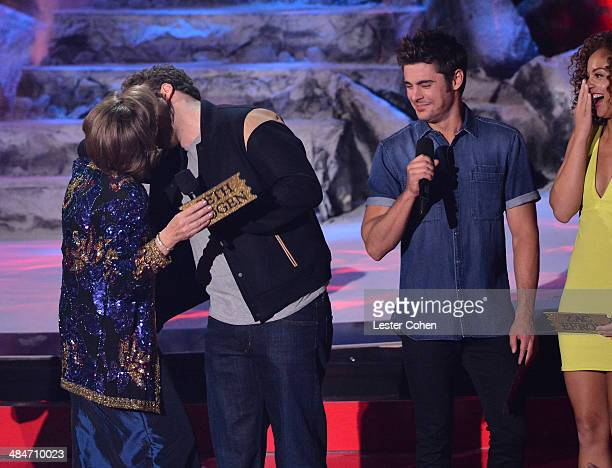 Actors Sandra Daubert Seth Rogen Zac Efron and Tiffany Luce speak onstage at the 2014 MTV Movie Awards at Nokia Theatre LA Live on April 13 2014 in...