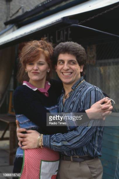 Actors Sandy Ratcliff and Nejdet Salih pictured on the exterior set of the BBC soap opera 'EastEnders' December 14th 1984