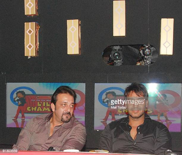 Actors Sanjay Dutt and Ajay Devgan pose on the sets of the music show Little Champs in Mumbai on Tuesday September 29 2009