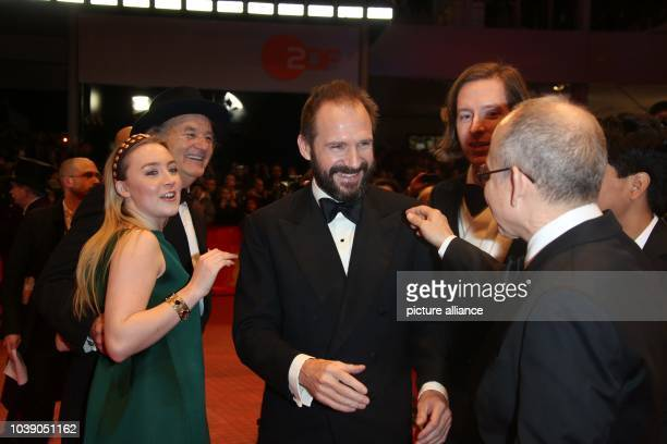 Actors Saoirse Ronan Ralph Fiennes director Wes Anderson and actor Bob Balaban attend the world premiere of 'The Grand Budapest Hotel' during the...