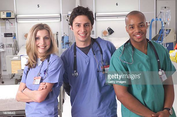 """Actors Sarah Chalke, Zach Braff, and Donald Faison poses for a publicity photo for the television show """"Scrubs."""""""
