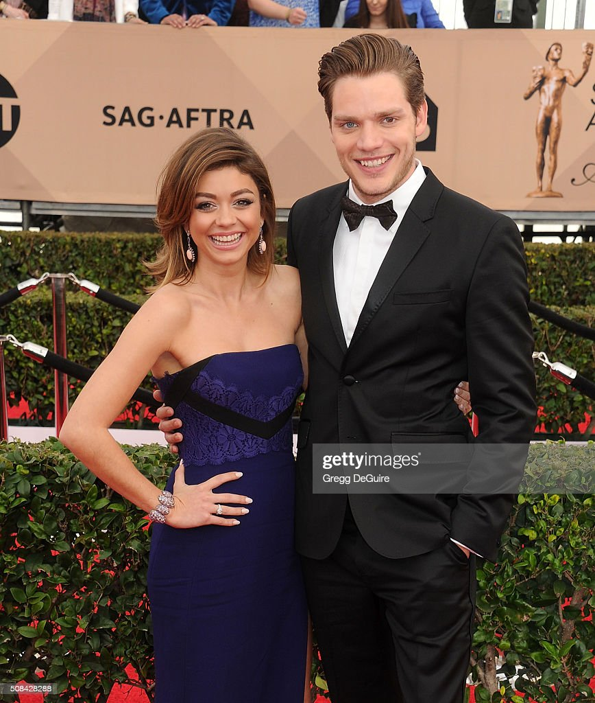 Actors Sarah Hyland and Dominic Sherwood arrive at the 22nd Annual Screen Actors Guild Awards at The Shrine Auditorium on January 30, 2016 in Los Angeles, California.