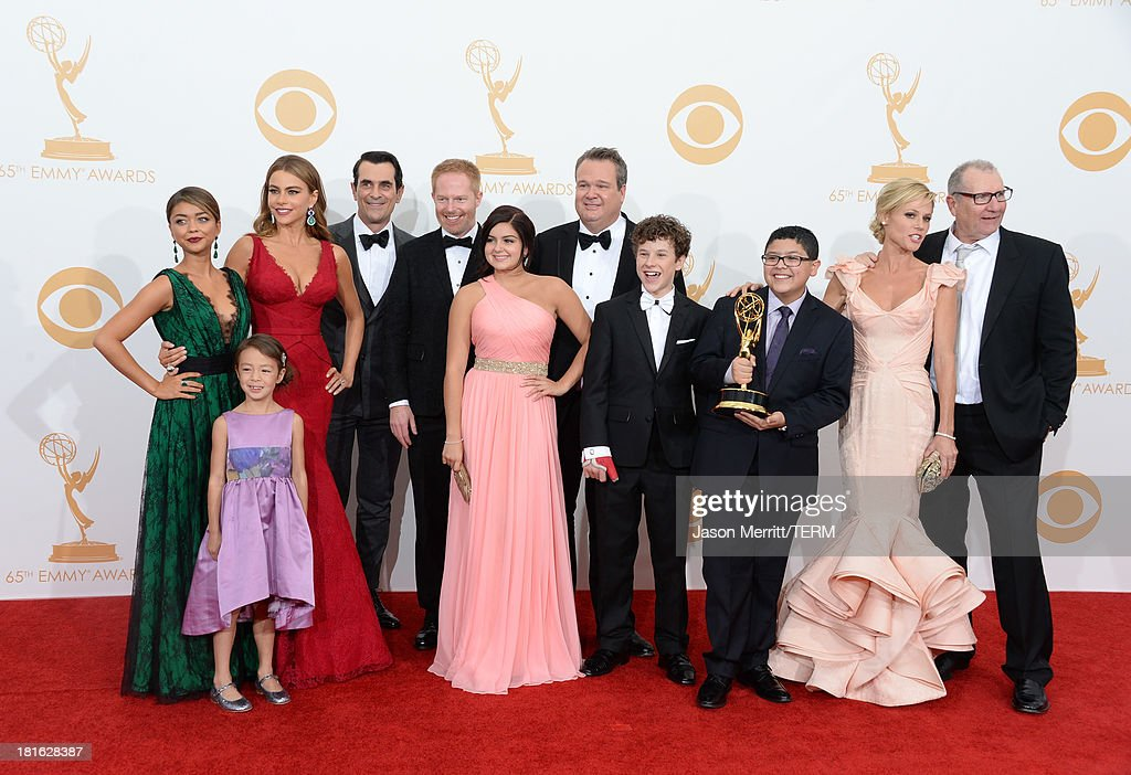 Actors Sarah Hyland, Aubrey Anderson-Emmons, Sofia Vergara, Ty Burrell, Jesse Tyler Ferguson, Ariel Winter, Eric Stonestreet, Nolan Gould, Rico Rodriguez, Julie Bowen and Ed O'Neill, winners of Outstanding Comedy Series for 'Modern Family,' pose in the press room during the 65th Annual Primetime Emmy Awards held at Nokia Theatre L.A. Live on September 22, 2013 in Los Angeles, California.
