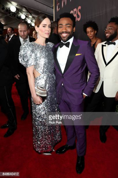 Actors Sarah Paulson and Donald Glover walk the red carpet during the 69th Annual Primetime Emmy Awards at Microsoft Theater on September 17 2017 in...