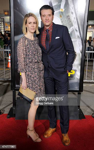 Actors Sarah Paulson and Jason Butler Harner arrive at the Los Angeles premiere of NonStop at Regency Village Theatre on February 24 2014 in Westwood...