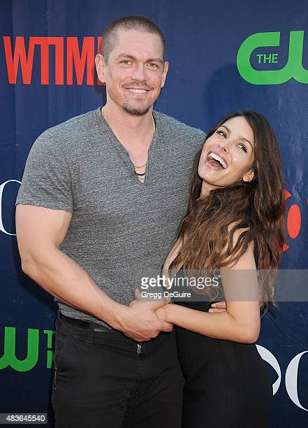 Actors Sarah Shahi and Steve Howey arrive at the CBS CW And Showtime 2015 Summer TCA Party at Pacific Design Center on August 10 2015 in West...