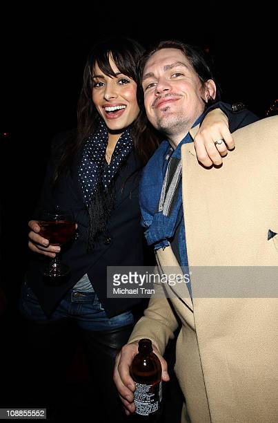Actors Sarah Shahi and Steve Howey attend DIRECTV and Mark Cuban's HDNet Super Bowl Party at Victory Park on February 5 2011 in Dallas Texas