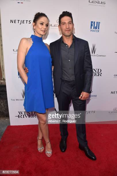Actors Sarah Wayne Callies and Jon Bernthal attend the premiere of The Weinstein Company's 'Wind River' at The Theatre at Ace Hotel on July 26 2017...