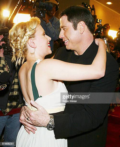 Actors Scarlett Johansson and John Travolta arrive at the premiere of Lions Gate's A Love Song for Bobby Long at the Bruin Theatre on December 13...