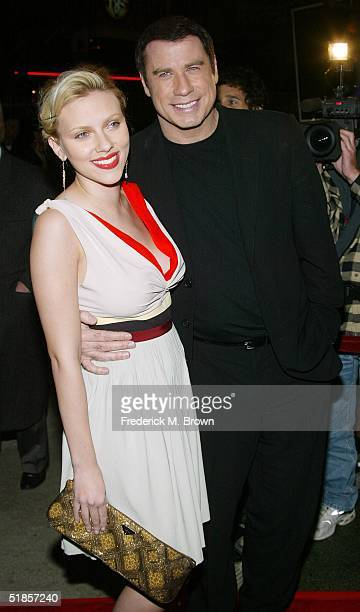 Actors Scarlett Johansson and John Travolta attend the film premiere of A Love Song For Bobby Long at the Mann Bruin Theater on December 13 2004 in...