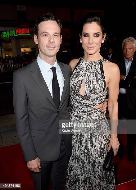 Actors Scoot McNairy and Sandra Bullock attend the premiere of Warner Bros Pictures' Our Brand Is Crisis at TCL Chinese Theatre on October 26 2015 in...