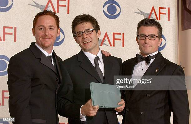 Actors Scott Grimes Rick Gomez and Frank John Hughes pose backstage during the American Film Institutes AFI Awards 2001 at the Beverly Hills Hotel...