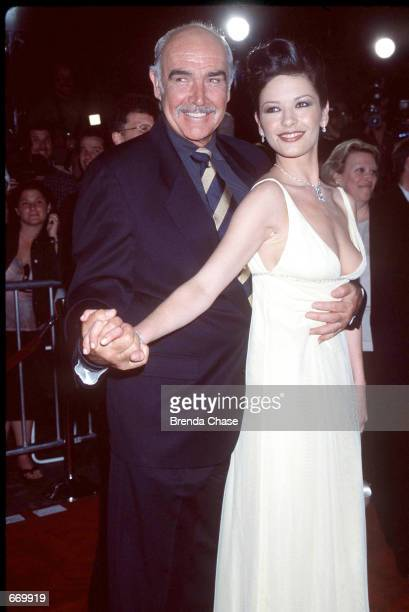 Actors Sean Connery and Catherine ZetaJones attend the premiere of their new movie 'Entrapment' April 15 1999 in Hollywood CA It has been reported...