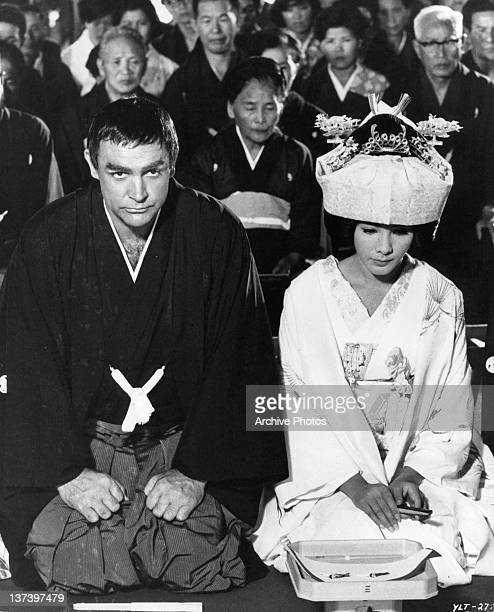 Actors Sean Connery and Mie Hama stage a fake Japanese wedding in a scene from the film 'You Only Live Twice' 1967