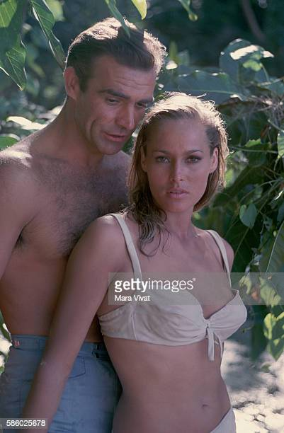 Actors Sean Connery and Ursula Andress stand together in Jamaica during the filming of Dr No
