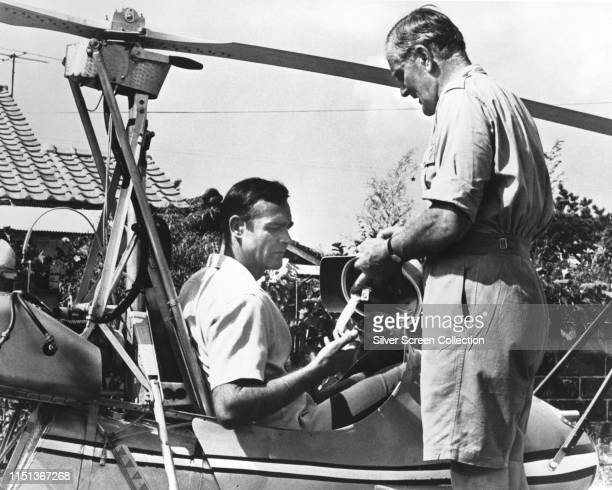 Actors Sean Connery as James Bond and Desmond Llewelyn as Q with the WA116 autogyro 'Little Nellie' in the spy film 'You Only Live Twice' 1967