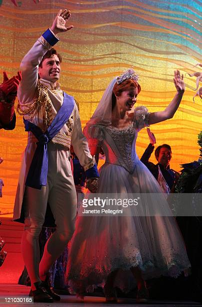 Actors Sean Palmer and Sierra Boggess take a bow during the curtain call at the debut of the Broadway Play The Little Mermaid at the LuntFontanne...