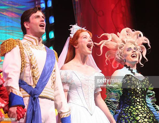 Actors Sean Palmer Sierra Boggess and Sherie Rene Scott take a bow during the curtain call at the debut of the Broadway Play The Little Mermaid at...