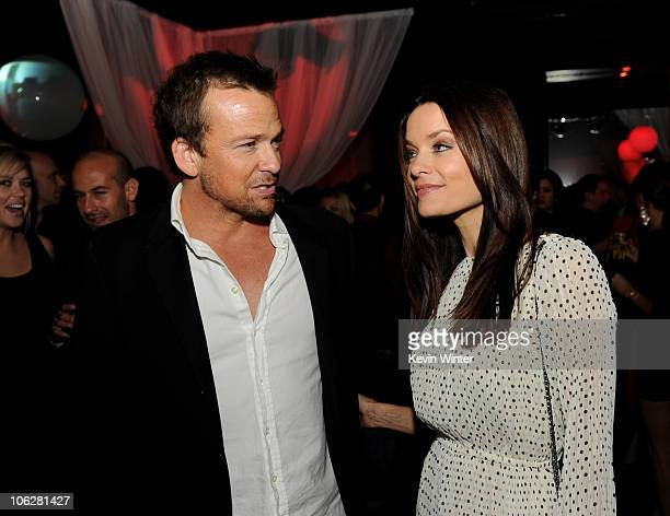 Actors Sean Patrick Flanery and Gina Holden pose at the after party for the premiere of Lionsgate's Saw 3D at Level 3 on October 27 2010 in Los...