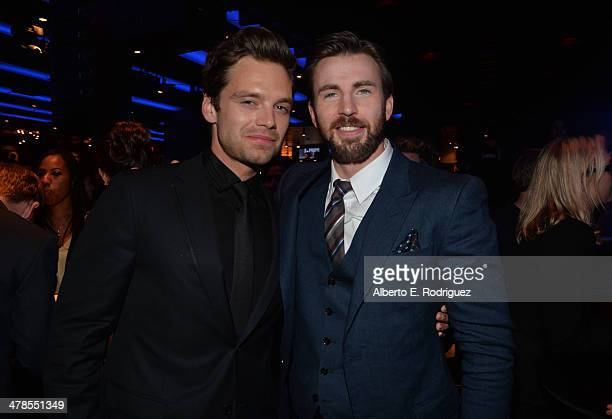 """Actors Sebastian Stan and Chris Evans attend the after party for Marvel's """"Captain America: The Winter Soldier"""" premiere at the El Capitan Theatre on..."""
