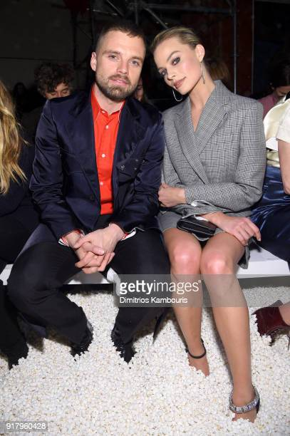 Actors Sebastian Stan and Margot Robbie attends the Calvin Klein Collection front row during New York Fashion Week at New York Stock Exchange on...