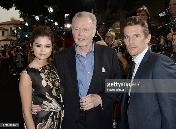 Actors Selena Gomez Jon Voight and Ethan Hawke arrive at the premiere of Warner Bros Pictures' Getaway at Regency Village Theatre on August 26 2013...