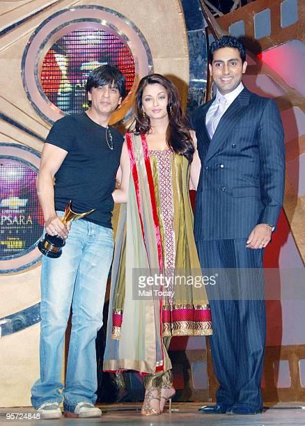 Actors Shah Rukh Khan Aishwarya Rai Bachchan and Abhishek Bachchan at the Apsara awards ceremony in Mumbai on Friday January 8 2010