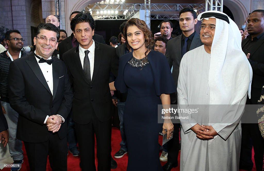 Actors Shah Rukh Khan Kajol Devgan and DIFF Chairman Abdulhamid Juma attend `The Clan` premiere during day four of the 12th annual Dubai...