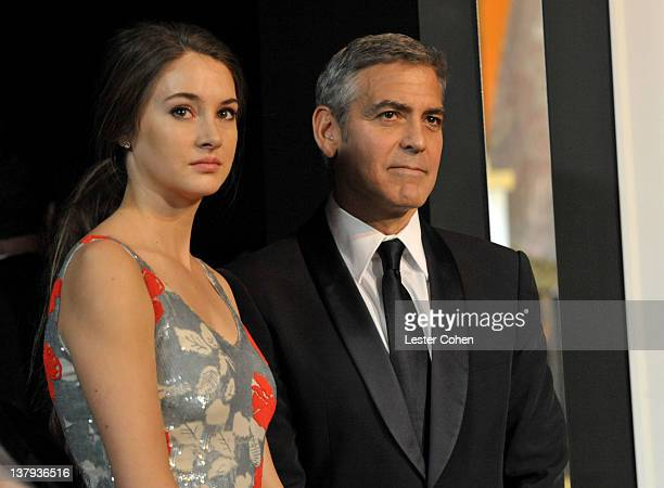 Actors Shailene Woodley and George Clooney attend The 18th Annual Screen Actors Guild Awards broadcast on TNT/TBS at The Shrine Auditorium on January...
