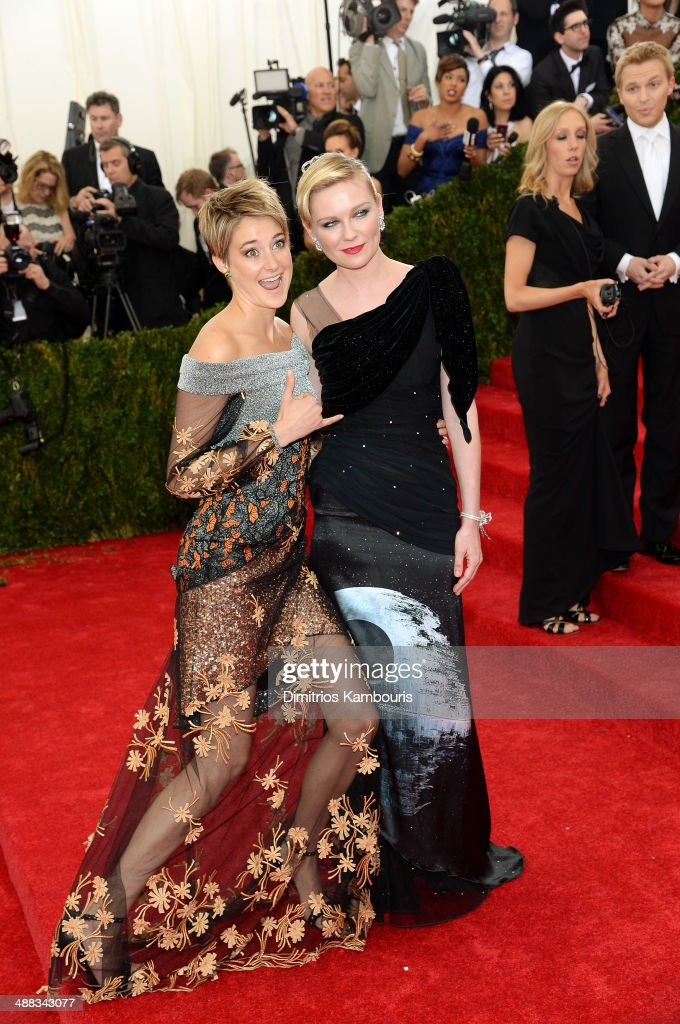 Actors Shailene Woodley and Kirsten Dunst attend the 'Charles James: Beyond Fashion' Costume Institute Gala at the Metropolitan Museum of Art on May 5, 2014 in New York City.