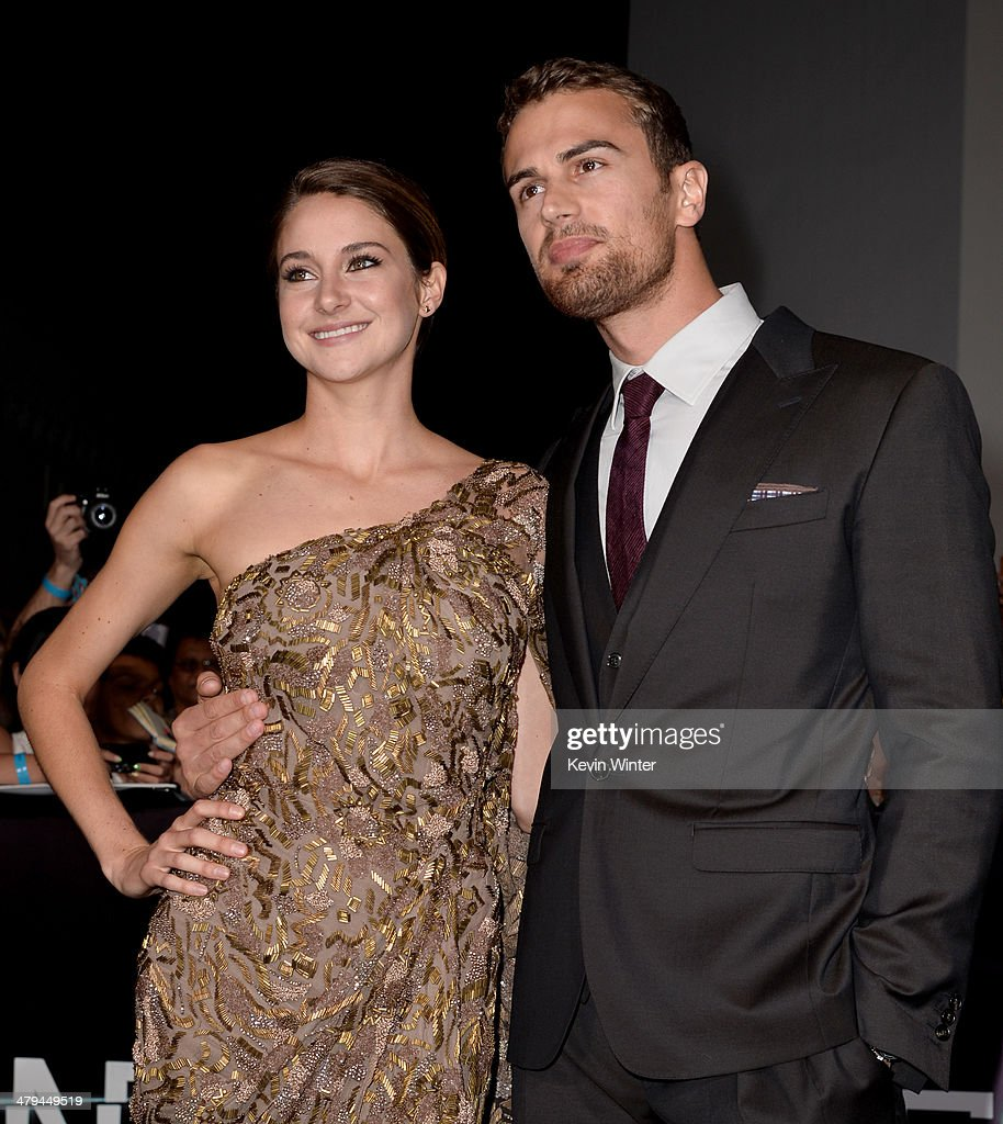 Actors Shailene Woodley (L) and Theo James arrive at the premiere of Summit Entertainment's 'Divergent' at the Regency Bruin Theatre on March 18, 2014 in Los Angeles, California.