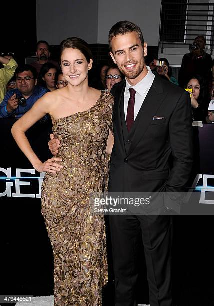 Actors Shailene Woodley and Theo James arrive at the premiere of Summit Entertainment's 'Divergent' at the Regency Bruin Theatre on March 18 2014 in...