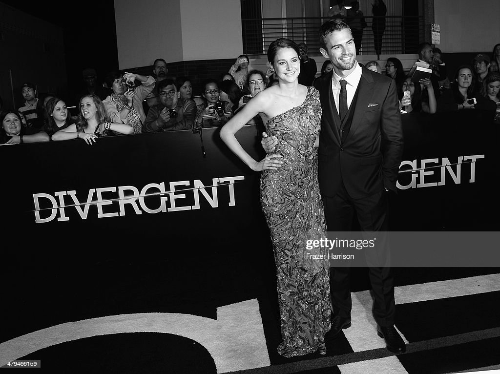 Actors Shailene Woodley and Theo James arrive at the premiere Of Summit Entertainment's 'Divergent' at Regency Bruin Theatre on March 18, 2014 in Los Angeles, California.