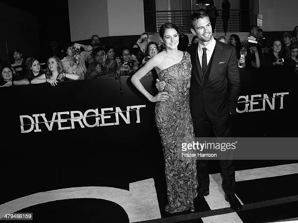 Actors Shailene Woodley and Theo James arrive at the premiere Of Summit Entertainment's 'Divergent' at Regency Bruin Theatre on March 18 2014 in Los...