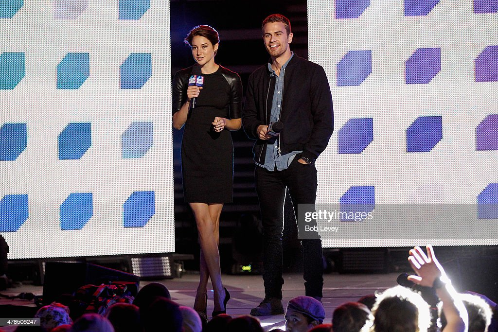 Actors Shailene Woodley (L) and Theo James speak onstage at the 2014 mtvU Woodie Awards and Festival on March 13, 2014 in Austin, Texas.